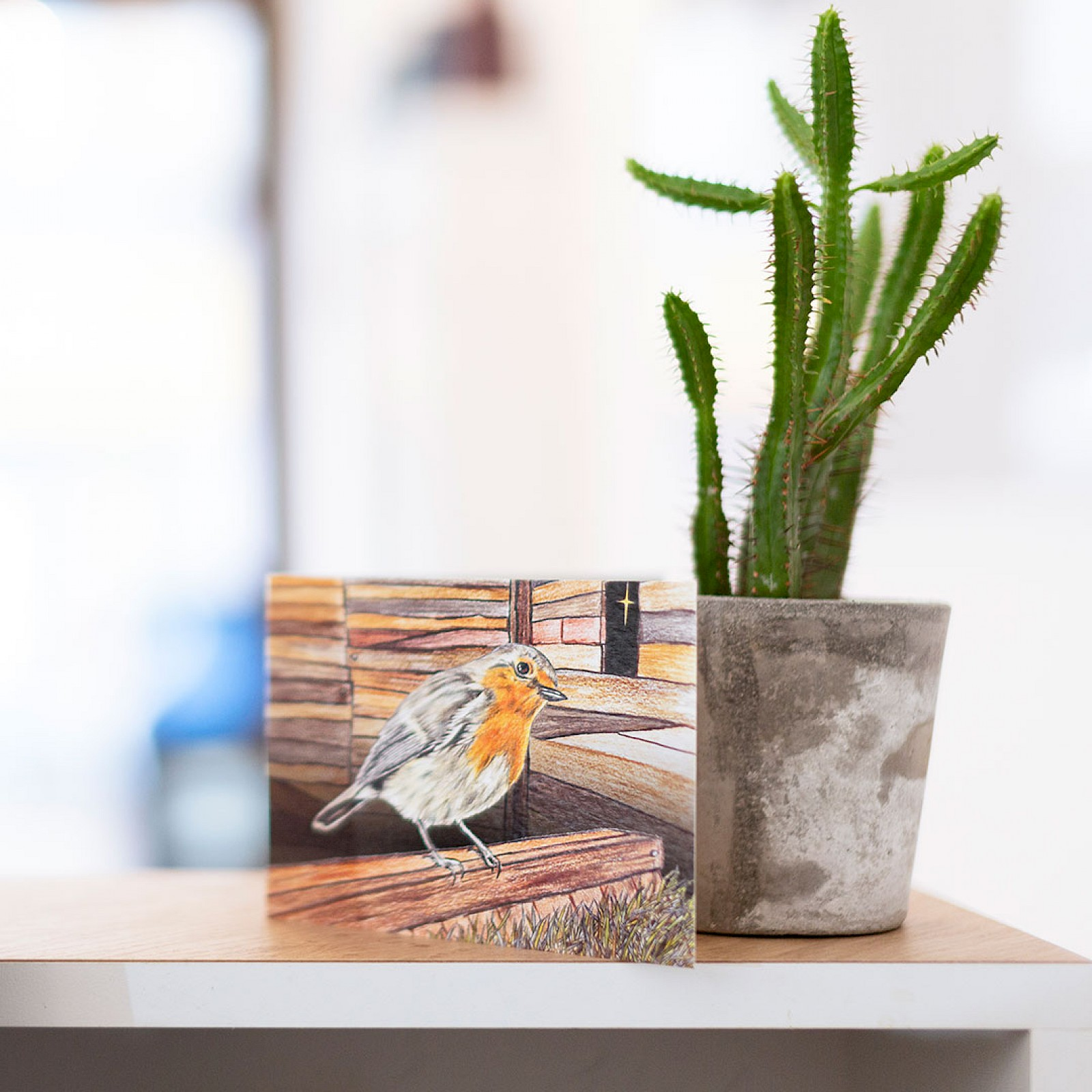 Austin lafferrty reception desk with a picture of a robin